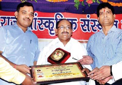 Awarded by Shri Pankaj Yadav                              (District Magistrate Meerut) and Mr. MM Beg (SP Dehat) to Mr. Mahesh Sharma For Best                              Matrimonials Services
